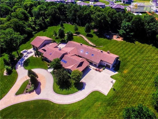 Welcome to 20905 W. 106th Street in Millcreek Farm subdivision on 2.5+/- acres.  This drone view captures the extreme beauty of the property. (photo 1)