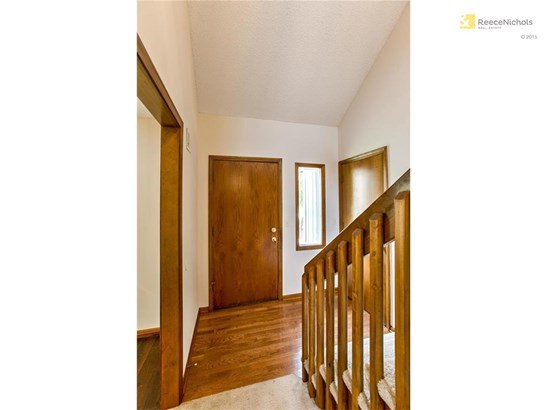 Wood floor at entry. (photo 2)