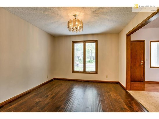 Enjoy the formal dining room with wood floors. (photo 4)