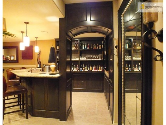 Custom wet bar with granite counter, mini frig, microwave and lots of built-ins. (photo 4)