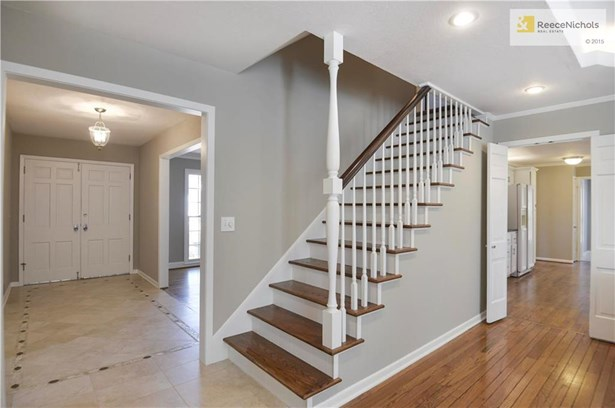 As you enter the double door entry you are greeted by the tile entry with accent pattern.  This view boasts the newly refinished hardwood stairs that lead to the 2nd floor. (photo 3)