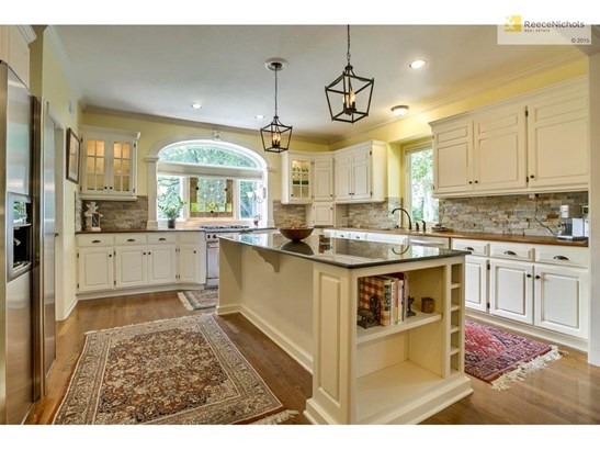 Exquisite kitchen with beautiful light cabinetry, stack-stone back splash goes beautifully with walnut and granite counter tops! (photo 5)