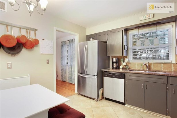 Updated kitchen with title and granite counter tops (photo 1)