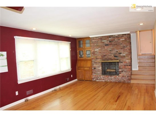 Large Living Room with a beautiful view of the private back yard. (photo 3)