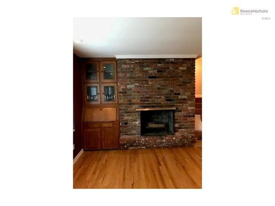 Stunning brick fireplace.   Built in desk has beautiful stain glass windows. (photo 4)