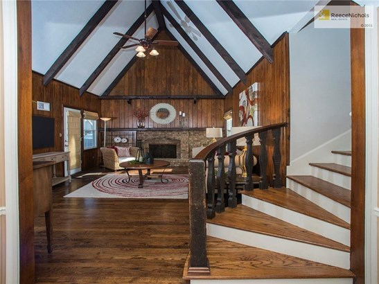 WOW - First impressions do make a difference - vaulted Family Room with beautiful hearth, windows, door to deck and CHECK OUT THOSE STAIRS!!!! (photo 4)
