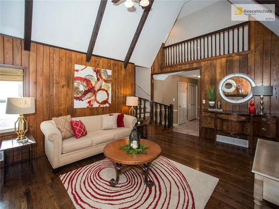 Family Room is VERY comfortable and cozy - view of balcony overlook and back to foyer. (photo 5)