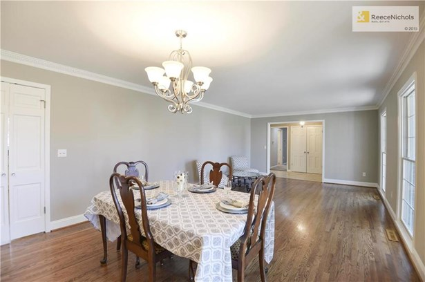 This Living Room/Dining Room combo boast GORGEOUS hardwood floors that were recently refinished.  The double doors in the picture offer direct access to the kitchen for convenience. (photo 2)