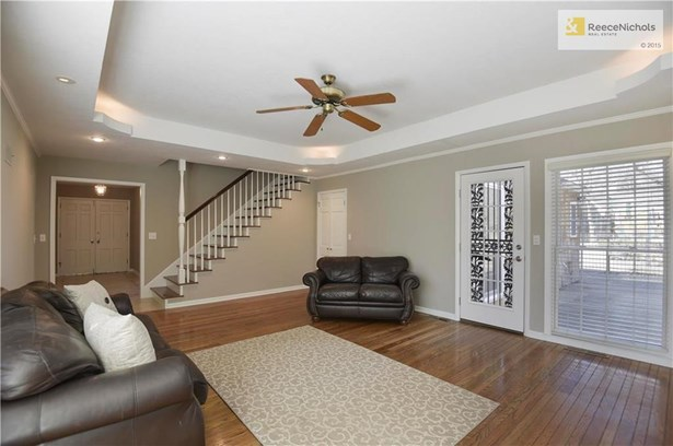 Additional view of the Family Room shows the staircase to the 2nd floor which is where you will find the 4th bedroom with en suite bath. (photo 5)