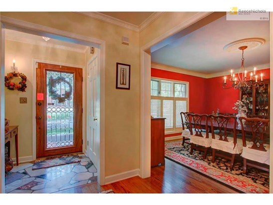 The entry shows off a taste of the detailed  crown molding and the gleaming hardwood floors. (photo 3)