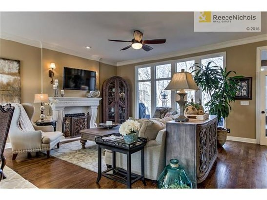 Large Living Area with Hardwood Floors & Wall of Windows! (photo 5)