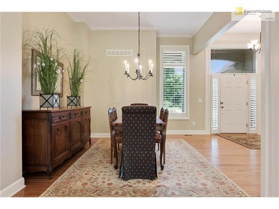 The family room is open with lots of windows to view your private treed lot. (photo 4)