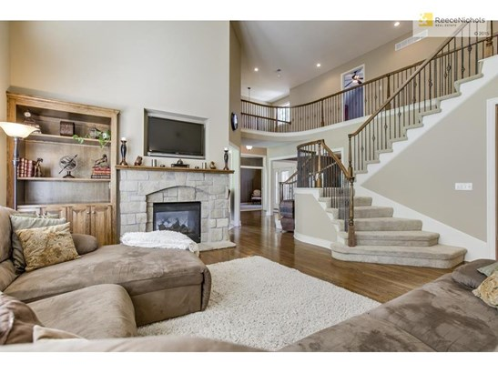 Soaring Ceilings and tons of upgrades.  Fantastic double sided staircase! Wired for flat screen TV (photo 1)