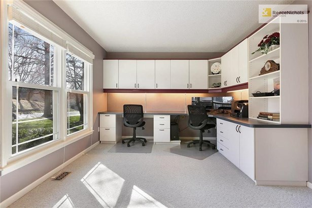 Formal living room being used as an office. (photo 4)