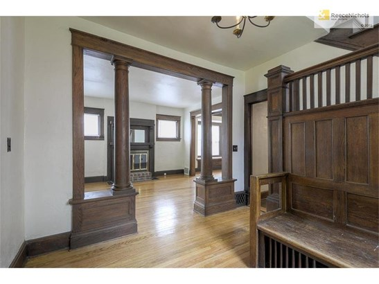 Large entry surrounds you with original, warm woodwork. (photo 3)
