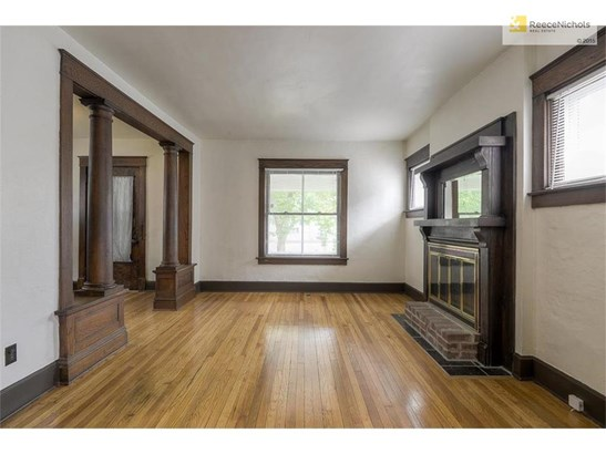 Shining wood floors throughout the home exemplify its excellent condition. (photo 4)