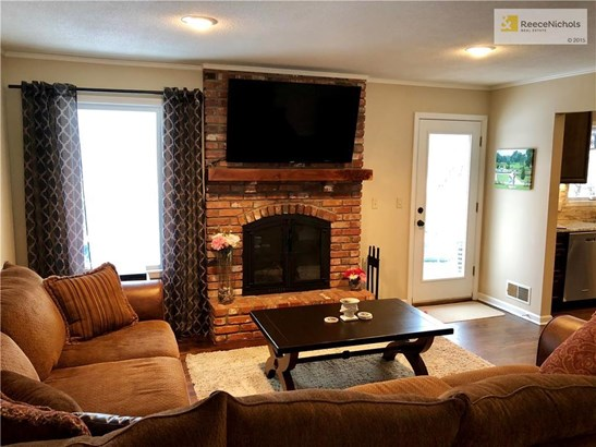 Living Room with entrance to backyard! Cozy fireplace, Newer HVAC! (photo 5)