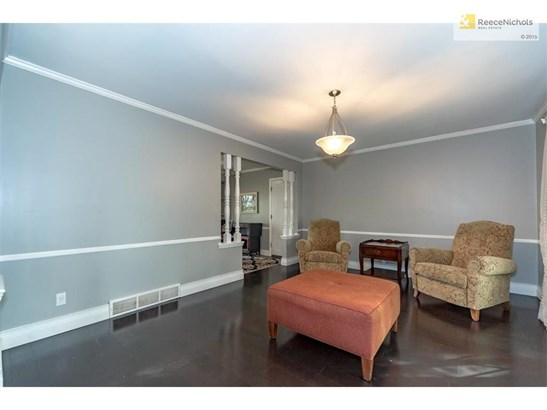 Recent interior paint in today's cool palette looks stunning against the dark wood flooring in the living room. (photo 2)