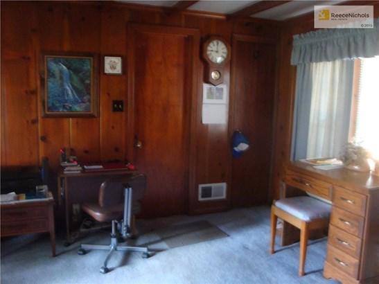 Paneled den w/garage access (photo 5)