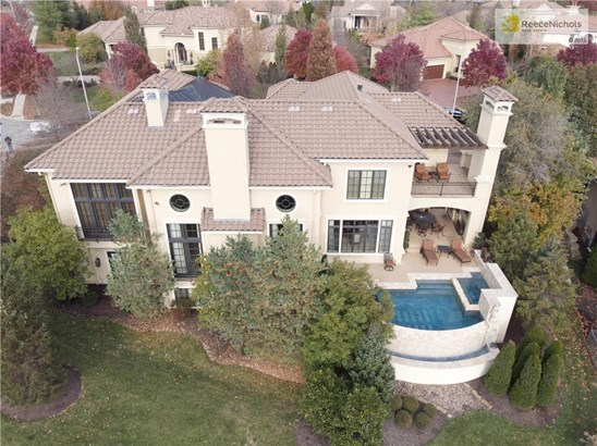 Infinity edge pool with hot tub off patio with outdoor kitchen & FP