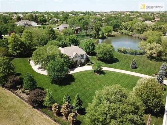 Stunning rare opportunity to own almost 3 acres and half of a pricate lake in the heart of Leawood. (photo 1)