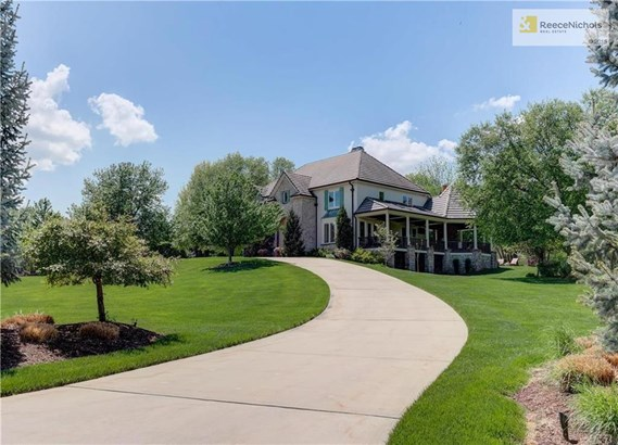 Lush landscape, beautiful covered patio overlooking the lake and property and stunning views. (photo 3)