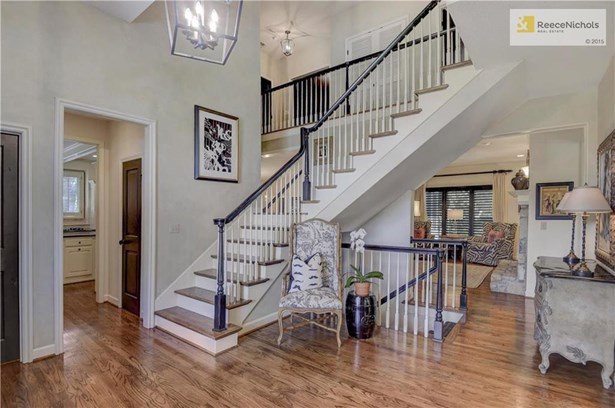 Grand two story entry with lush hardwood flooring and arched doorway. (photo 5)
