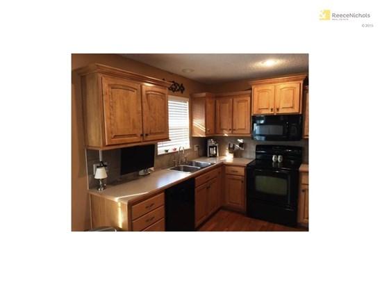 Custom cabinets, tiled back splash, hardwood floors, premium dishwasher. (photo 2)