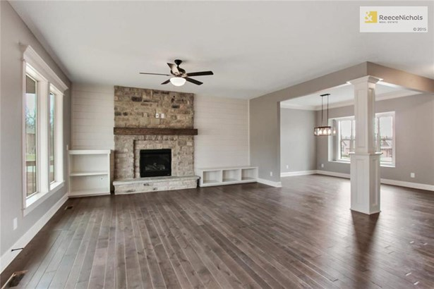 Living Room Fireplace Is The Center Of Attention (photo 5)