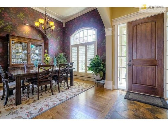 Spacious dining room- perfect for small or large gatherings with plantation shutters! (photo 3)