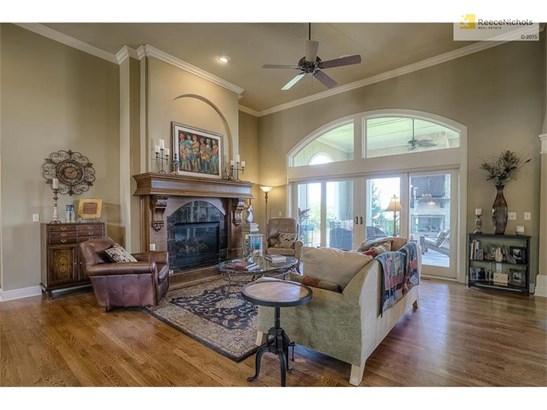 Great room with high ceilings, granite fireplace & beautiful hardwood flooring! (photo 4)