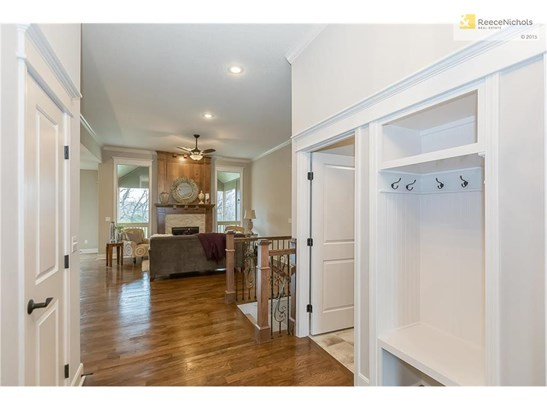 From the front door: Nice open view into the main level living room with that statement fireplace and floor-to-ceiling windows. Hall closet is to your left. Easy access to the laundry room on your right. (photo 3)