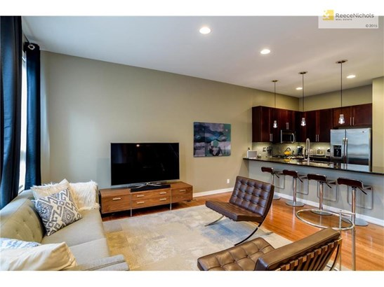Open concept with Living Room opening into the Kitchen & Dining Room (photo 3)