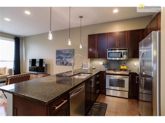 Kitchen boasts updated backsplash, granite countertops & stainless steel appliances (photo 5)
