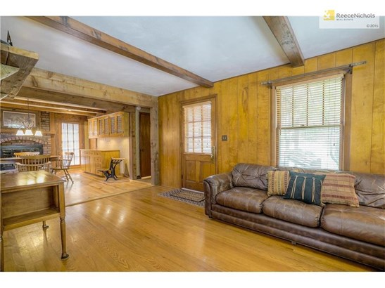 Hardwood floors and cedar beams in the main living area. (photo 3)