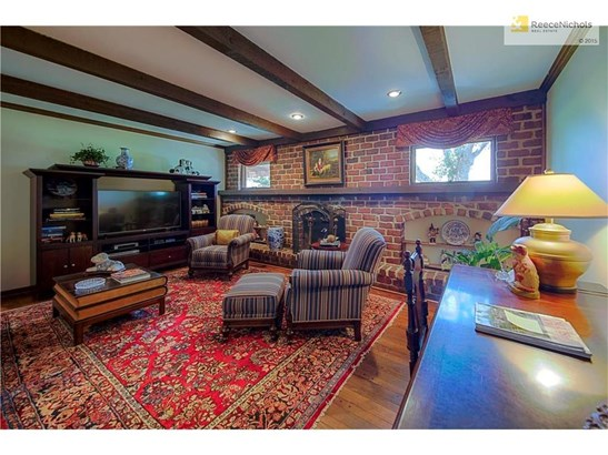 COZY UP IN YOUR BEAMED CEILING LIVING ROOM WITH FEATURE FIREPLACE AND BRICK BUILT-INS (photo 4)