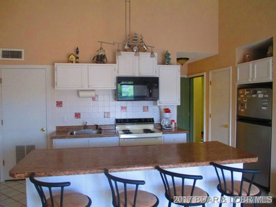 KITCHEN AND DINING AREA (photo 1)
