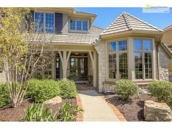 Elegant Iron doorway and charming front porch. (photo 2)