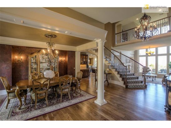 Walk into this spectacular entry and elegant iron chandeliers with crystals. (photo 4)