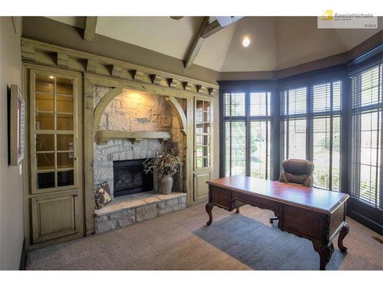 Private first floor office with built ins and fireplace. It has a vaulted ceiling with beams. (photo 5)