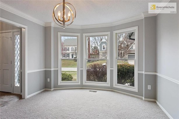 Enter through the front door into this spacious dining room with beautiful bay window. New flooring, paint, and light fixtures throughout this entire home. (photo 3)