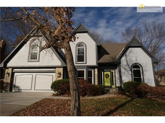 This beautifully remodeled two-story sits on a large lot and offers a walkout basement. (photo 1)