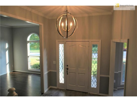 Step inside the home and into a lovely foyer and open staircase to the second level. The dining room and formal living room/sitting room are located on either side of the foyer. (photo 5)