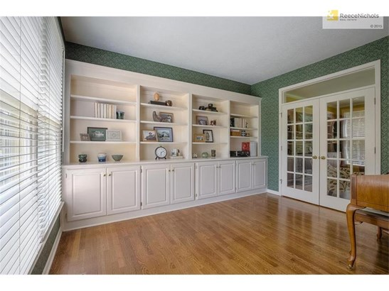 French doors, hardwood floors, shelves, & cabinets in main floor Library! (photo 4)