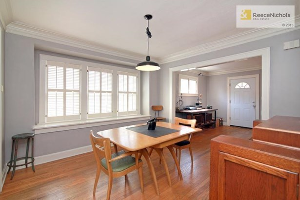 The dining room has 3 big windows! Light and bright with a nice window sill. Your plants will love you if you give them this place to call home. (photo 5)