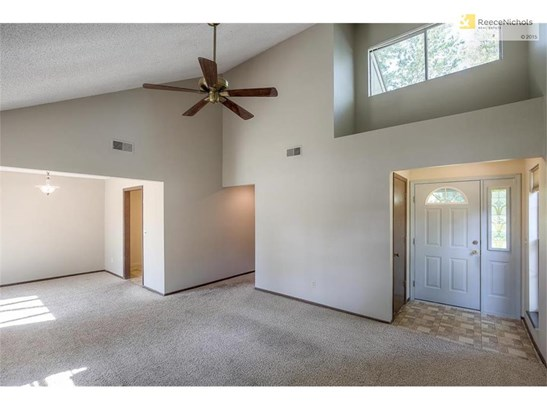 Family room looking at front door. (photo 5)