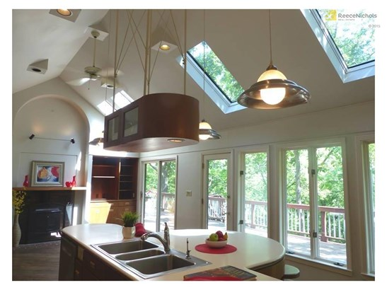 Fantastic open kitchen with wooded views, adjacent to the living room. (photo 3)