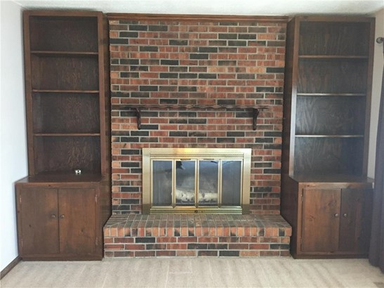 Woodburning Fireplace and built-ins on main level living room. (photo 3)