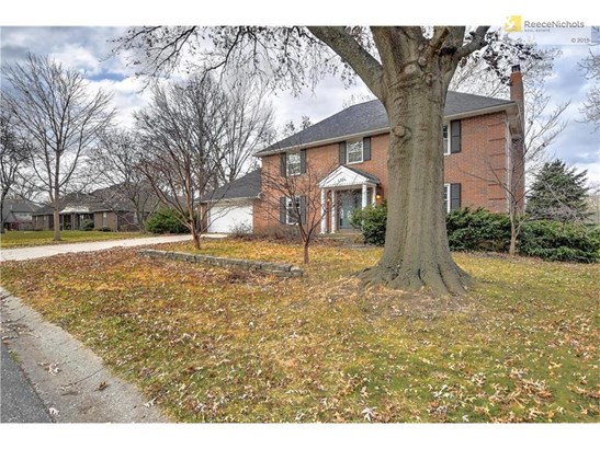 This grand, all brick two-story, Colonial home makes a statement as soon as you pull in the driveway! Brand new 50 year roof gives the home an updated and sharp new look. (photo 2)