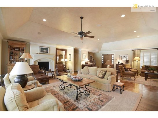 The formal living room boasts an ornate fireplace. (photo 4)